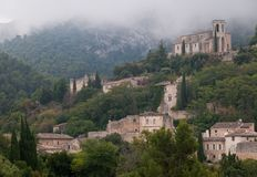 Oppede le vieux , french hilltop village . Oppede le vieux ,old hill top village in the south of france , provence , in the clouds Royalty Free Stock Photos