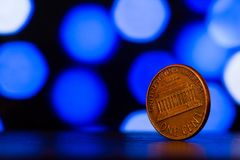 Free Сopper Coin On A Background Of Blue Bokeh Stock Photo - 119484290