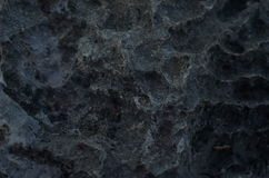 Oppervlakte rotsachtig kalksteen, grijze kalksteen en achtergrond in Thailand Stock Afbeeldingen