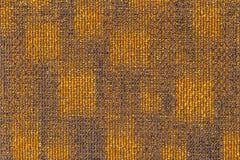 Oppervlakte van het grijsachtige oranje tapijt Stock Foto