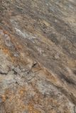 Oppervlakte van het marmer met bruine tint, steentextuur en achtergrond stock foto