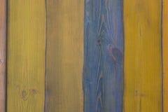 Oppervlakte van houten raad van donkerblauwe en gele kleuren Stock Afbeeldingen