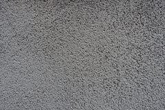 Oppervlakte van korrelig grijs muur vooraanzicht stock foto