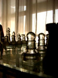 Opponents. A game of chess in progress Royalty Free Stock Photo