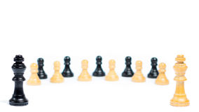 Opponents. Chess figures in front of white background - Two kings are in front of each other, their pawns are in the back Stock Photography