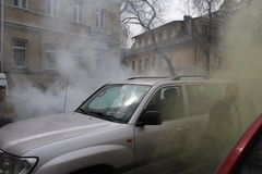 Opponents of Riot sprayed gas among crowd of supporters of the arrested muzakant, the audience near court. Stock Photos