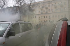 Opponents of Pussy Riot sprayed gas among crowd of supporters of the arrested muzakant, the audience near court. Royalty Free Stock Photo