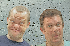 Opportunists at window Stock Photos