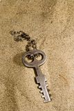 Opportunity. Old key found on the beach, conceptual, space for text at bottom Stock Photo