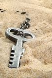 Opportunity. Old key found on the beach, conceptual, space for text at bottom Royalty Free Stock Images