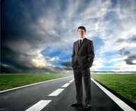 Opportunity. Business man standing on the road Royalty Free Stock Image