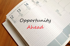 Opportunity Ahead Concept. Business Notepad on wooden table Opportunity Ahead Concept Royalty Free Stock Images