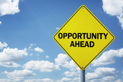 Opportunity ahead road sign. Concept for business development, progress, choice and direction or employment issues stock photography