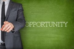 Opportunity on blackboard with businessman Stock Image