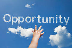 Opportunity cloud. Baby hand riching clouds opportunity Royalty Free Stock Photos