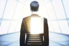 Opportunity concept. Back view of businessman in concrete room with open door. Opportunity concept. Double exposure Royalty Free Stock Photos