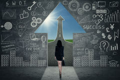Opportunity Concept. Business woman walking towards opportunity door Stock Image