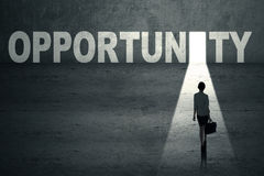 Opportunity Concept. Businesswoman walks toward an opportunity door Stock Photo