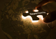 Opportunity concept. With hand opening the  puzzle Stock Photography