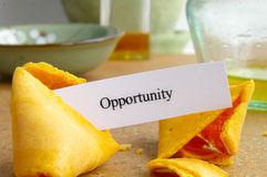 Opportunity cookie. Fortune cookie with paper opportunity message, closeup stock images