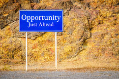 Opportunity, Just Ahead. Opportunity, Just Ahead Green Road Sign at cliff Royalty Free Stock Photography