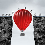 Opportunity Manager. And problem solver business concept as red air balloon creating a support link to help a team of businesspeople cross towards a corporate Royalty Free Stock Photography