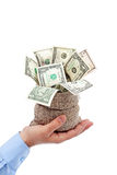 Opportunity presented - sack of money offered by male hand Royalty Free Stock Images
