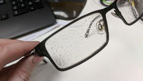 Condensation droplets on a glasses frame royalty free stock photo