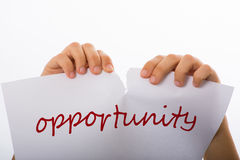 Opportunity. Woman tearing sheet of paper with the word opportunity Stock Photography