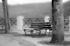 Opposing benches of yesteryear Royalty Free Stock Images