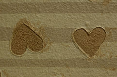 Opposing brown hearts Stock Photography