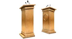 Opposing Debate Podiums. Two opposing regular wooden debate podiums signifying a debate on an isolated white studio background Stock Images
