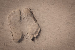 Opposing footprints Left Stock Photos