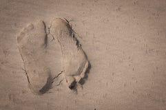 Opposing footprints Left Stock Photos