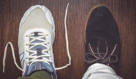 Opposing shoe styles Stock Photos