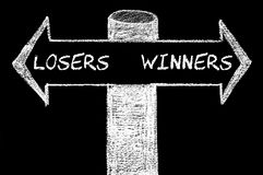 Opposite arrows with Losers versus Winners Royalty Free Stock Photos