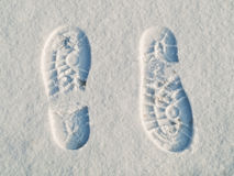 Opposite direction footprints Stock Image