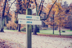Opposite directions towards year 2014 and 2015 Royalty Free Stock Photos