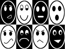 Opposite emotions. Black and white opposite smiley face Royalty Free Stock Photography