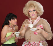 Opposite Personalities With Tea Cup Stock Image