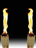 Opposite Tiki Torches Royalty Free Stock Image