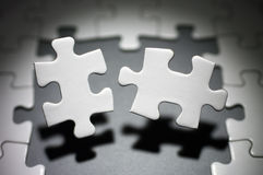 Opposite two jigsaw puzzle pieces. Royalty Free Stock Photo