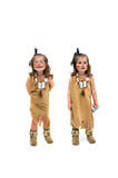 Opposites. Laughing and serious, two images of little girl, dressed as an indian squaw, are captured with all white background. Costume represents Thanksgiving royalty free stock image