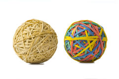 Opposites. Two rubberband balls, illustration of opposites, or being different and refusing to be ordinary or boring stock image