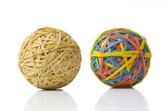 Opposites. Two rubberband balls, illustration of opposites, or being different and refusing to be ordinary or boring stock photos