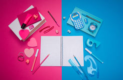Opposites attract. Concept with male light blue desk and girly pink desk, stationery and heart shaped stick notes stock photo
