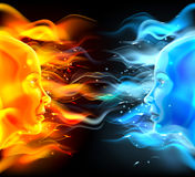 Opposites Faces Concept. Of two faces with fire or flames one hot orange and one cold blue. Could be a concept for the sun and moon, hot and cold, summer and Stock Photo