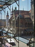 Opposites. Look through glass curtain wall towards old city hall and market place stock photos