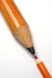 Oppositie van een klein en groter potlood Stock Foto