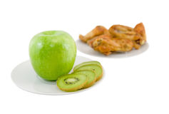 Opposition-healthy meal and unhealthy chiken. Stock Image